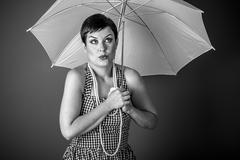Pinup girl style of the 50s with a white umbrella Stock Photos
