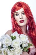 Beautiful redhead woman with bouquet of white flowers dressed in medieval era Stock Photos