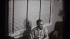 1941: a lively and relaxed man sitting on a chair in a room while smiling NY Stock Footage