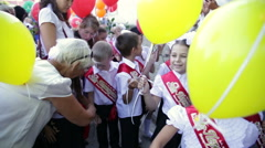Girls with yellow balloons. School. First Grade. 1 September. Stock Footage