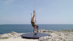 Professional pole dancer during outdoor extreme fitness workout Stock Footage