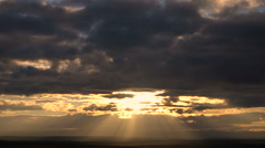 The Sun's Rays Fan Out From Clouds at Sunset Beautiful Taymlaps Stock Footage
