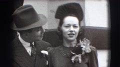 1941: a lovely couple giving a romantic kiss to each other in a gathering NY Stock Footage