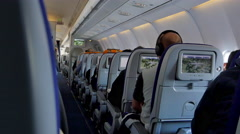 4K Jet Airplane Seats, Flat Screen LCD TV Monitors, Movies Shows Entertainment Stock Footage