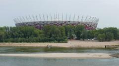 Warsaw, Poland. The Vistula river and National Stadium building Stock Footage
