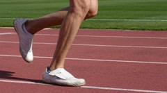 Strong healthy body legs man run on running stadium tracks during relay race  Stock Footage