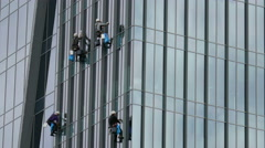 Four window cleaners at work Stock Footage