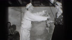 1941: sailor offers woman his handkerchief in bare room NEW YORK Stock Footage