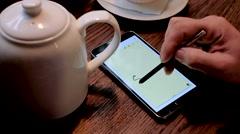 Man writes SOS inscription on the smart phone screen Stock Footage