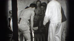 1941: sailors and laymen and even a woman are getting seats ready  Stock Footage