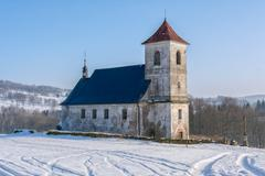 The church in snowy landscape Stock Photos