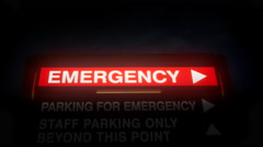 4K Direction Sign to Emergency Room at Hospital at Night Stock Footage
