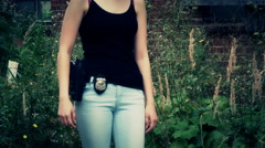 Close up of female cop with badge and gun Stock Footage