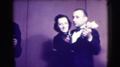 1941: several couples wearing elegant formal attire are dancing happily NEW YORK Stock Footage