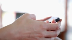 Close-up shot of female hand typing SMS message Stock Footage