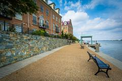 Bench and apartment buildings on the Potomac River waterfront, in Alexandria, Stock Photos