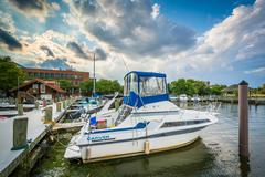 Boats docked on the Potomac River waterfront, in Alexandria, Virginia. Stock Photos