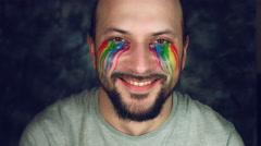 4k LGBT Shot of Rainbow Coloured Man Tears Smiling Happy Stock Footage