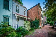 Houses and brick sidewalk in the Old Town of Alexandria, Virginia. Stock Photos
