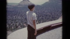 1966: father and son enjoy beautiful scenery with stunning architecture Stock Footage