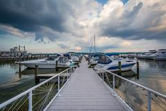 Pier and boats on the Potomac River waterfront, in Alexandria, Virginia. Stock Photos