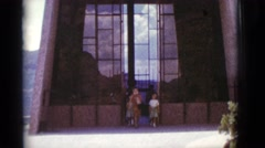 1966: family walks out of building CLARKSDALE, ARIZONA Stock Footage