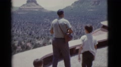 1966: people looking out over a breathtaking view of a canyons and mountains Stock Footage