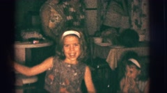 1966: girls singing and dancing very animatedly in the home environment Stock Footage