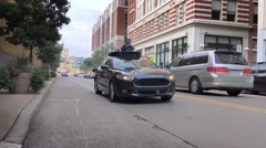 Self-Driving Uber Car Rides on Roads in Pittsburgh Stock Footage