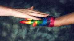 4k LGBT Shot of Rainbow Coloured Hand With a Girl's Hand Stock Footage
