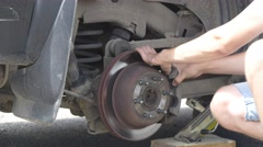 Fixing car wheel on the road Stock Footage