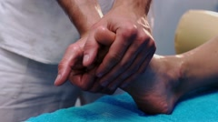 Male hands massaging patient's feet Stock Footage