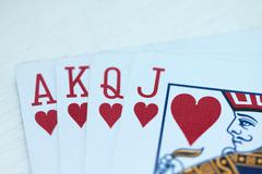 Playing cards with hearts Stock Photos