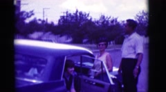 1966: standing by a car CLARKSDALE, ARIZONA Stock Footage