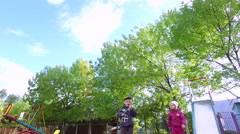 Blond boy and girl with glasses start flying chopper. Children play on the Arkistovideo