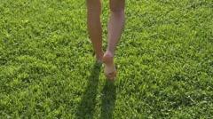 Woman walk barefoot on soft grass Stock Footage