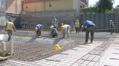 Workers group installing armature at building construction by Sheyno. Stock Footage