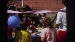 1972: a lot of children having food from the table at a party LYNBROOK, NEW YORK Stock Footage