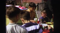 1972: family cookout in backyard with children and hotdogs LYNBROOK, NEW YORK Stock Footage