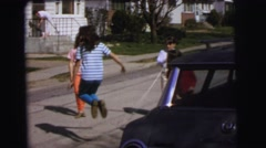 1972: girls playing jumping rope on the roads LYNBROOK, NEW YORK Stock Footage