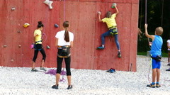 Climbing the rock wall / Training / Children / 4K Stock Footage
