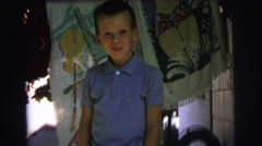 1972: a boy loves his hair cut if it is given by his own father  Stock Footage