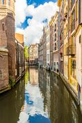 Narrow Amsterdam canal Stock Photos