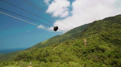 Young slim woman on zip line with gopro in hands, Puerto Galera, Philippines Stock Footage
