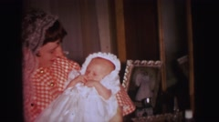 1972: a baby wearing a beautiful dress in baptism ceremony day LYNBROOK Stock Footage