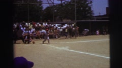 1972: baseball game in the ground watched by many people LYNBROOK, NEW YORK Stock Footage