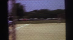 1972: boy hits a fly ball in baseball outfielder catches  Stock Footage