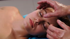 Male hands massaging woman's face Stock Footage