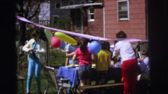 1972: various people and kids enjoying a birthday party outdoors LYNBROOK Stock Footage