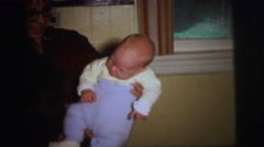 1972: home video of baby being picked up and sleeping on chair LYNBROOK Stock Footage
